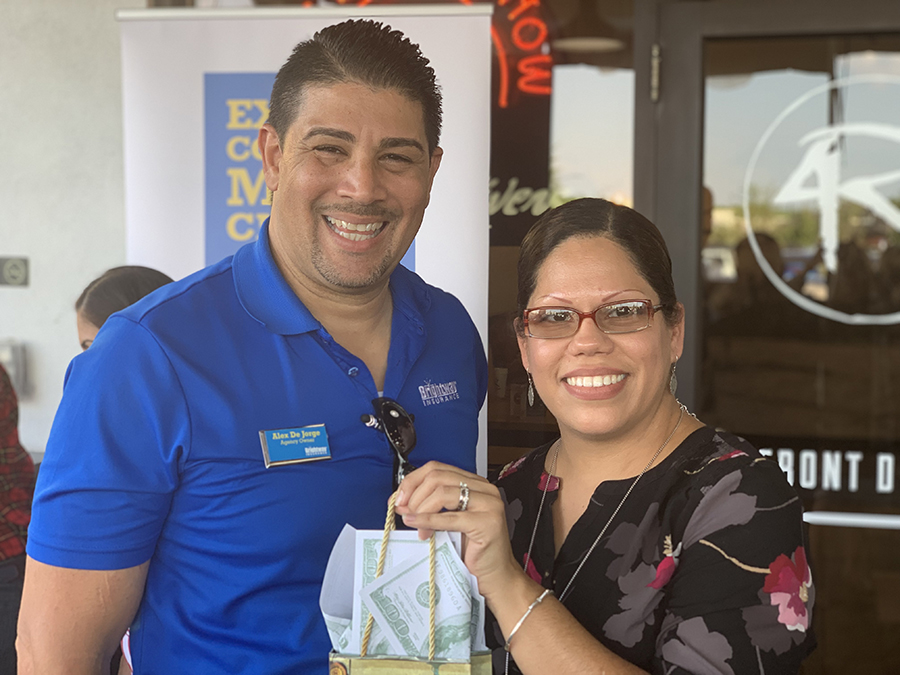 2019 PBC Chairman Alex De Jorge with a raffle prize winner at a Link Osceola event
