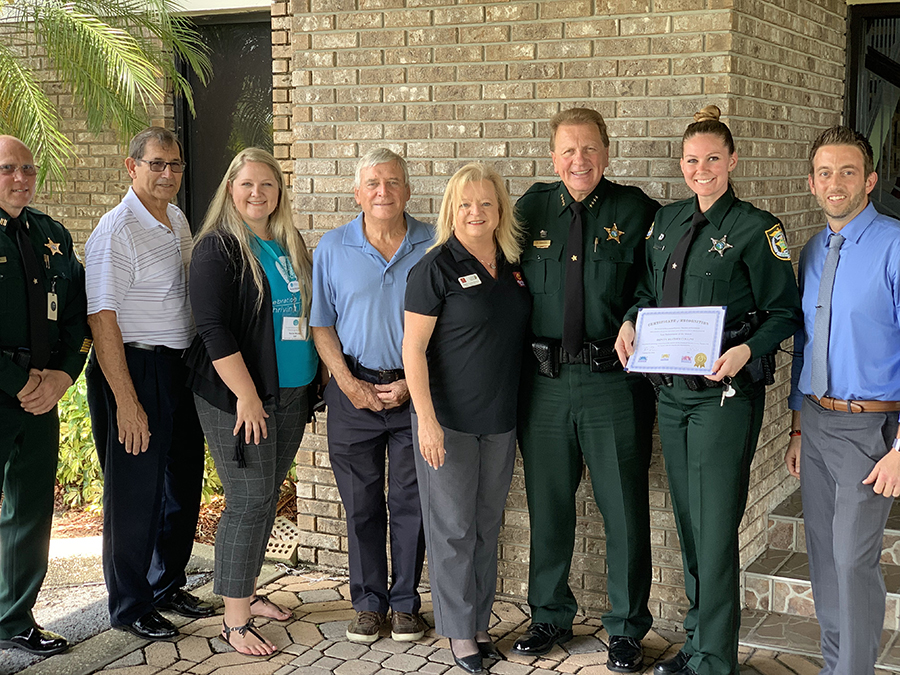 Members of the ORAC Board with a Back the Blue Award recipient